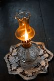 Flame of an ancient oil lamp. In the night Royalty Free Stock Photos