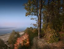 Flame of autumn. View from the hill to the vastness of the Volga River Russia, Ulyanovsk. Flame of autumn. View from the hill, overgrown with forest and bushes Stock Image