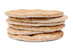 Flame baked pitas on white background. Stack of flame baked pitas on white background Stock Photo