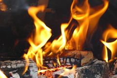 Flame in a barbecue fire place Royalty Free Stock Photo