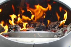 Flame in a barbecue fire place Stock Photos