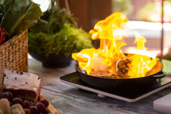 Flame in black pan. Royalty Free Stock Image