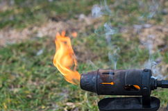 Flame of a blowtorch. Flames and smoke blowtorch closeup Royalty Free Stock Image