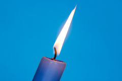 Flame of blue candle Stock Images