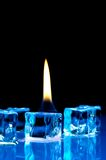 Flame on blue ice cubes Royalty Free Stock Photography