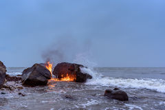 Flame between of the boulders Stock Photos