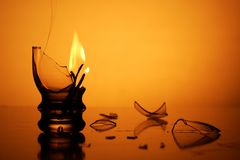 Flame in broken glass Royalty Free Stock Image