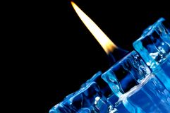 Flame burning on blue ice cubes Stock Photography