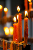 Flame of burning candles in a temple Stock Image