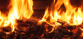 Flame from the burning logs in the fireplace Royalty Free Stock Image