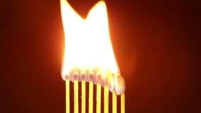 Flame burning matches stock video footage