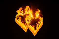 Flame-burning silhouettes of the heart. Stock Images