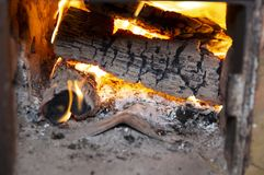 Flame of burning wood in the firebox stock images