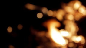 Flame burns out of focus stock footage