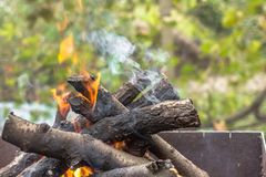 Smokestack on fire wood stock image