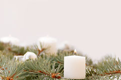 Flame of the candle and fir branch Royalty Free Stock Images
