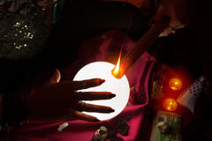 Flame of candle and hand of fortune teller woman Royalty Free Stock Photos