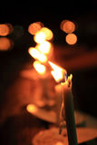 Flame on candle with light bokeh on background Stock Images
