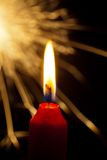 Flame of a candle with a sparkler Royalty Free Stock Photography