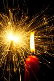 Flame of a candle with a sparkler Royalty Free Stock Photo