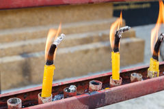 Flame of candle in temple Stock Photo