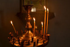 The flame church candles. Beautiful church burning wax candles Royalty Free Stock Images