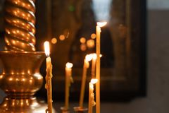 The flame of Church candles lit in the Church stock photography