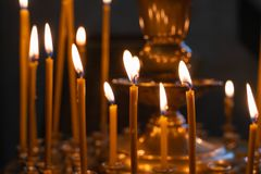 The flame of Church candles lit in the Church royalty free stock photo