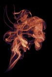Flame-coloured Smoke on Black Stock Photo