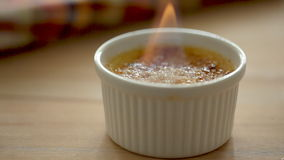 Flame on the creme brulee stock video footage