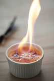 Flame on the creme brulee Stock Image