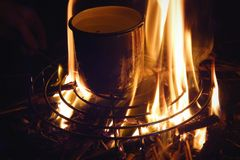Flame. A cup on the flame royalty free stock photography