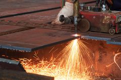 Flame cutting process by oxygen and acetylene cutting machine Stock Photos