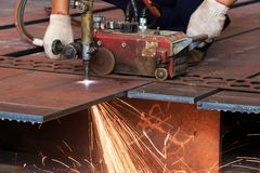 Flame cutting process by oxygen and acetylene cutting machine Stock Photo