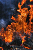 Flame of fire. With smoke Royalty Free Stock Image