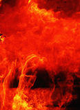 Flame of fire background. Background of fire as a symbol of hell and eternal torment Stock Photos