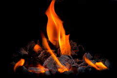 Flame , fire. Fire is the rapid oxidation of a material in the exothermic chemical process of combustion, releasing heat, light, and various reaction products.[1 Royalty Free Stock Photography