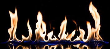 Flame of fire with reflect. Flame of fire on a black background with reflect , panorama shot stock image