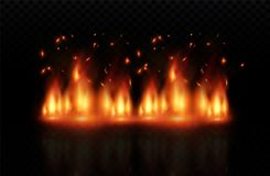 Flame of fire with sparks on a black background. The texture of the fiery storm.a shot of a flying spark in the air.over. Flame of fire with sparks on a black Stock Photography