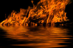 Flame fire water reflection Royalty Free Stock Photography