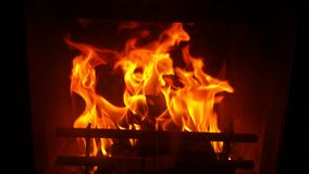 Flame from the fireplace in the dark Royalty Free Stock Photo
