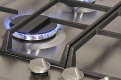 Flame gas burner on the gas hob. Closeup Royalty Free Stock Photography
