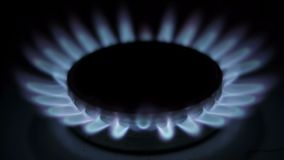 Flame of a gas burner in the kitchen stove Royalty Free Stock Photography