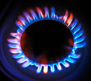 Flame gas stove in the dark. Royalty Free Stock Photos