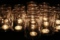 Flame in the glass cup. Scenery of the flame in much glass cups on Christmas Stock Photo