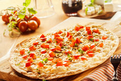 Flame grilled traditional french Alsatian pizza Stock Images