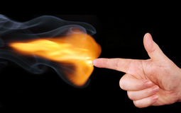 Flame on the hand, folded gun. Stock Photography