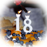 Flame ignition candles on the cake Royalty Free Stock Photos
