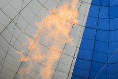 Flame inside of blue-white hot air balloon, natural selective focus. For modern background, pattern, wallpaper, banner Stock Images