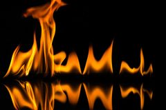 Flames isolated on black. Flame isolated on black background, bright fire Stock Images